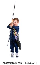 Happy 3 years old boy, holding a handmade bow with an arrow and a quiver, preparing to shoot, isolated on white -  front view