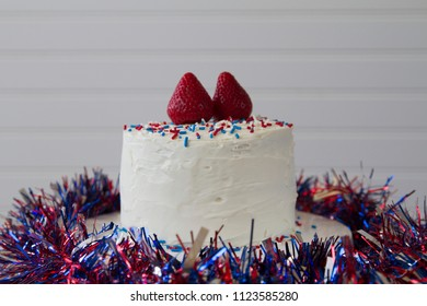 Happy 4th of July conceptual image with a homemade cake with patriotic decoration. With plenty of copy space.