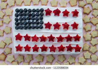 Happy 4th of July conceptual image with homemade cake that looks like American flag with many homemade star shaped cookies
