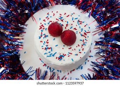 Happy 4th of July conceptual image with patriotic homemade cake.