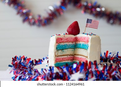 Happy 4th of July conceptual image with patriotic multicolored homemade layers cake.