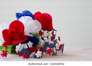 Happy 4th of July conceptual image with patriotic colored flowers.