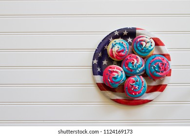 Happy 4th of July conceptual image with patriotic multicolored cupcakes.