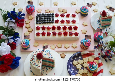 Happy 4th of July conceptual image with lots of homemade patriotic theme sweets party.