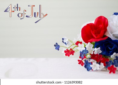 Happy 4th of July conceptual image with patriotic colored flowers with white background.
