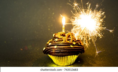 Happy 50th Birthday Cupcake With Candle And Sparkler Gold Black