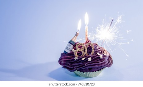 Happy 80th Birthday Cupcake with Candle and Sparkler