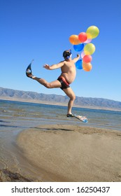 Happy absurdly Infantile man at vacation on sunny beach