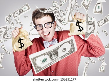 Happy accountant man enjoying the rain of falling money while holding tax return money bags.  Business success concept