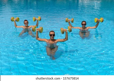 Happy active fitness people doing exercise with aqua dumbbell