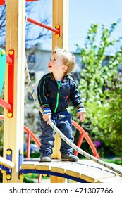 happy active toddler boy on the playground