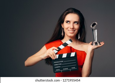 Happy Actress Holding Cinema Clapboard and Special Award. Successful movie star receiving trophy at film festival