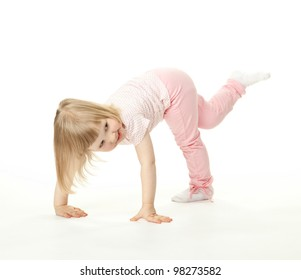 Happy adorable baby girl having fun; active child  playing on white background