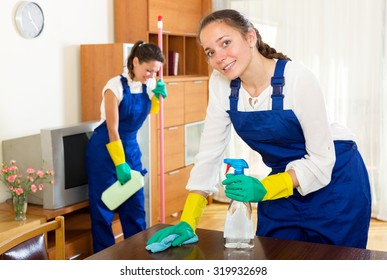 Happy adult female workers cleaning company ready to start work