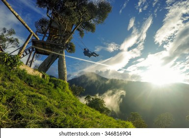 Happy Adult Man Swinging On A Swing Located At Casa Del Arbol, Ecuador, South America, Tree House