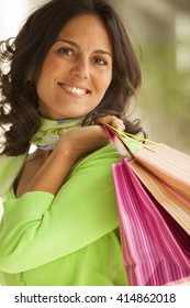 Happy adult woman with shopping bags