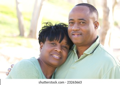 Happy Affectionate Couple posing in the park.
