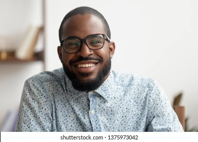 Happy african american black business man hr e coach smiling talking looking at camera webcam making conference video call, online job interview, shooting blog webinar, head shot portrait