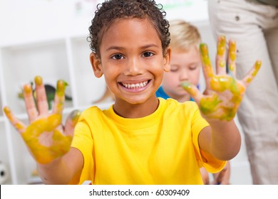 happy african american boy with hand paint