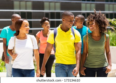 happy african american college students walking together on campus