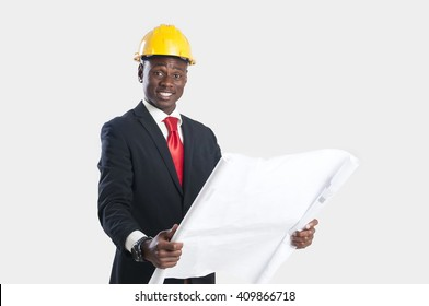 Happy african american construction worker holding blueprints isolated on white.