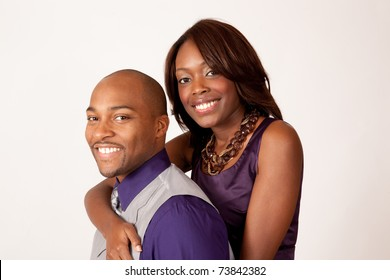 Happy African American couple embracing and smiling