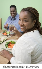 Happy African American couple having healthy meal together