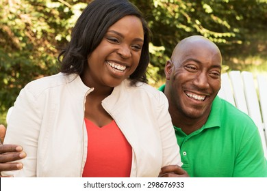 Happy African American couple outdoors looking away