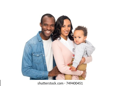 happy african american family with one child smiling at camera isolated on white