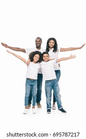 happy african american family standing with open arms and smiling at camera isolated on white