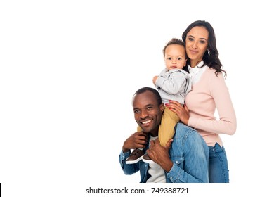 happy african american family standing together and smiling at camera isolated on white
