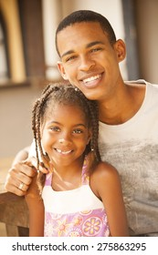Happy african american father and daughter smiling