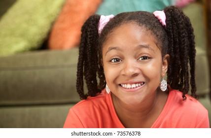 Happy African American girl in her room