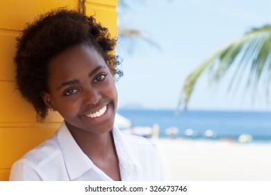 Happy african american girl near beach