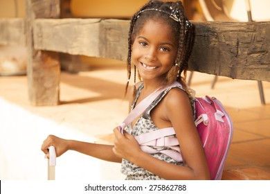 Happy african american girl smiling with backpack, back to school