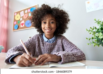 Happy african american kid child girl school student looking at web cam talking with remote teacher distance learning video conference call virtual class lesson, headshot zoom portrait, webcam view.