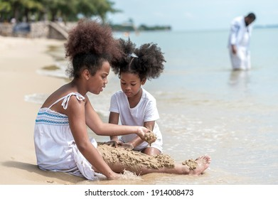 happy african american Little girl play and  buried in sand on the beach