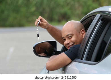 Happy african american man with his new car