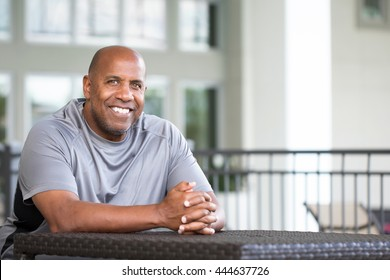 Happy African American man looking at the camera