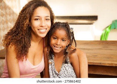 Happy african american mother and daughter smiling