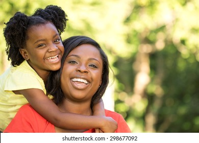 Happy African American mother and daughters.
