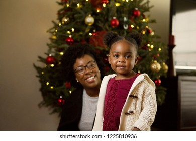 Happy African American mother and his daugher at Christmas.
