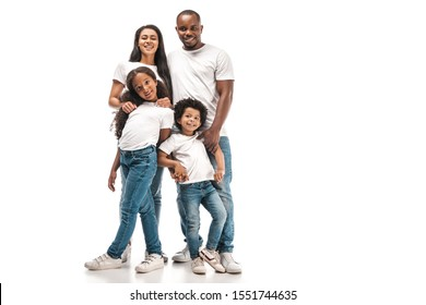happy african american parents with daughter and son smiling at camera while standing on white background