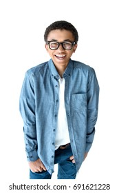 happy african american teenage boy in eyeglasses looking at camera while posing isolated on white