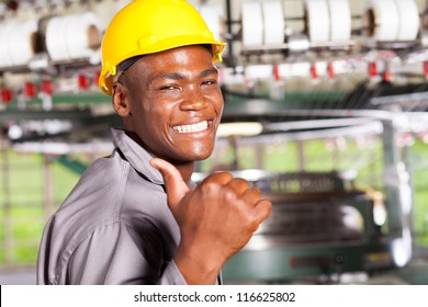 happy african american textile worker thumb up in factory