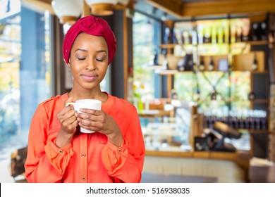 happy african american woman drinking tea  cup or mug