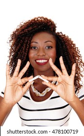 A happy African American woman holding a cigarette and breaking it,no more smoking, isolated for white background.