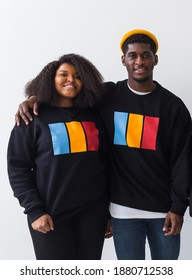 Happy African American woman and man have relationships, toothy smile, happy to meet with friends, dressed casually on white background. Emotions and friendship concept.