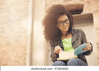 Happy african american woman reading book