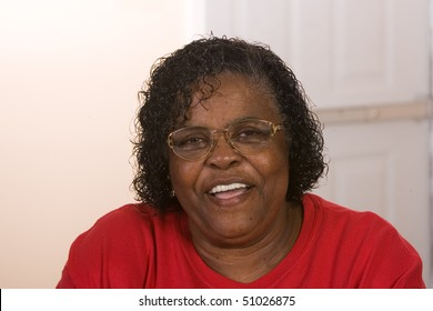 Happy African American Woman wearing glasses smiling.
